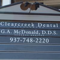 Logo for Clearcreek Dental Associates  Dr. Greg McDonald