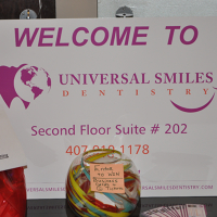 Logo for UNIVERSAL SMILES DENTISTRY PA