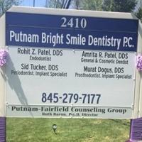 Logo for Putnam Bright Smile Dentistry